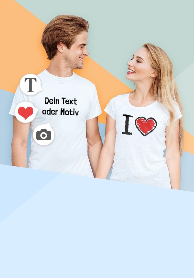 Junges Paar in T-Shirt mit eigenen Motiven